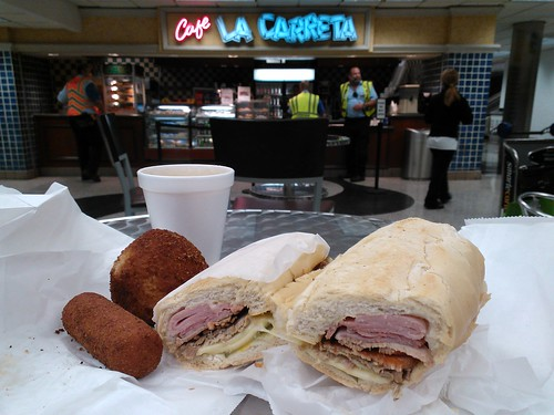 From left: croqueta, papa rellena, cafe con leche, and a Cuban sandwich