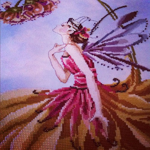 I stitched this piece years ago by my daughters request. #crossstitch #fairy #beads #dmc