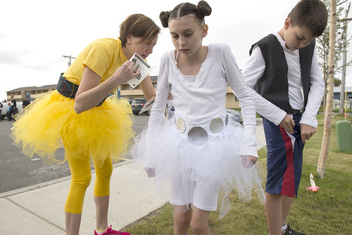 Angie Kenner helps her daughter Kelsie and son Jaron prepare for Saturday's Superhero 5k.