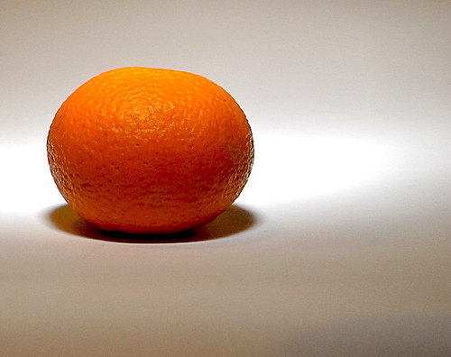 Orange - Less distracting is the softened light and reduced highlights on the surface.