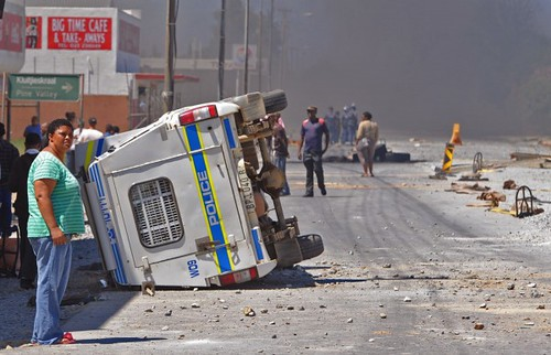 Police vehicle overturned in the Cape province amid an agricultural workers strike in the Republic of South Africa. An agreement to end the strike had been announced by the Allied Agricultural Workers Union an affiliate of COSATU. by Pan-African News Wire File Photos