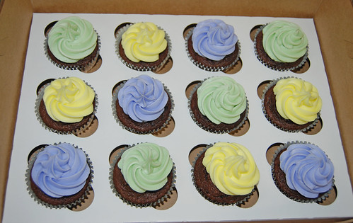pastel purple yellow and green baby shower cupcakes