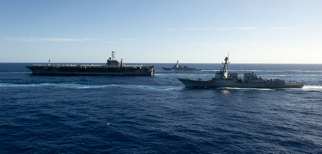 Ships from the John C. Stennis Strike Group transit the Pacific Ocean during a photo exercise