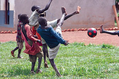 A group engages in a rousing game of futbol.  Futbol is known as soccer in the United States.