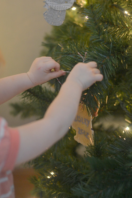 Violet hanging her ornament