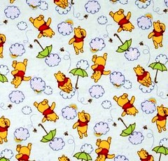 Winnie the Pooh Umbrella Toss Flannel Fabric