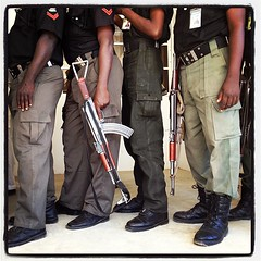 Nigerian police officers wait to have impromptu eye exams at Government House in Kano, Nigeria on Friday, December 7, 2012.
