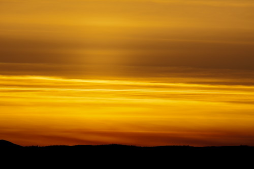 sunset red sky orange cloud sun mountain canada black mountains silhouette yellow clouds landscape gold golden glow bc okanagan hill pillar scenic silhouettes sunsets hills valley glowing kelowna