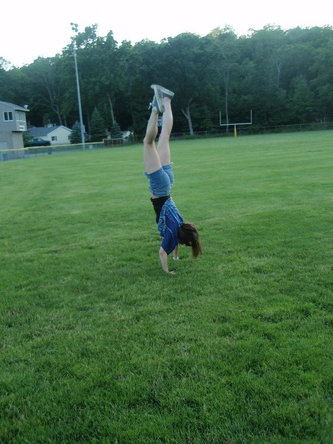 handstand in a field