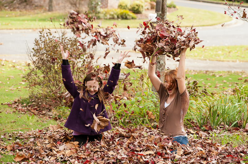 Girls playing in the leaves