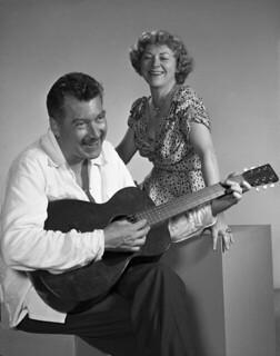 Novelist MacKinlay Kantor playing the guitar: Sarasota, Florida