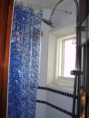 Shower room with thermostatic rain shower and jet shower heads