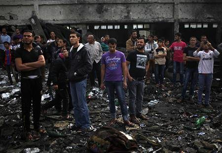 Palestinians viewing the extensive damage done by the Israeli Air Force in Gaza during the bombings of November 2012. The Israeli government waited until after the US elections to launch the assaults. by Pan-African News Wire File Photos