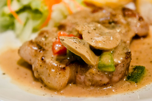 Santa fe Steak's Porkchop in mushroom and pepper sauce