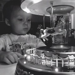 Day 4 - Black and White: He's obsessed with the broken, $5 Christmas carousel from Walgreens. #fmsphotoaday #clearancerack