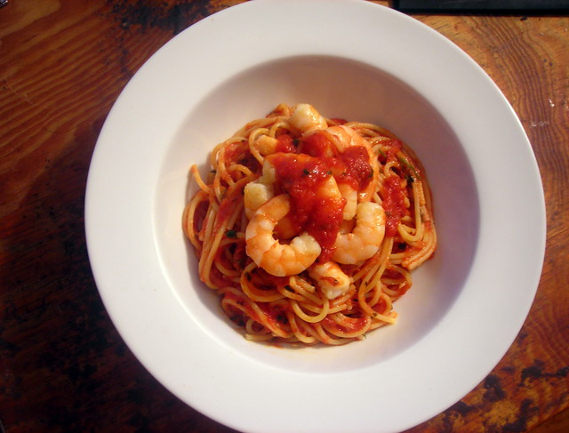 Spaghetti with marinara sauce, topped with garlic shrimp