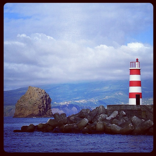 Lighted beacon tower, port of Madalena,Pico Island, Azores