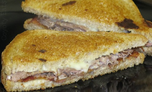 Grilled bacon, cheese, and roast beef on wheat by Coyoty