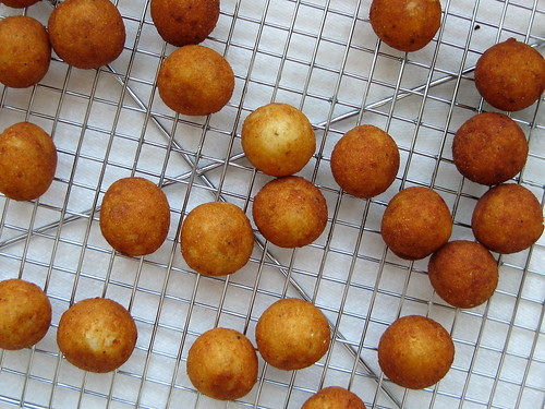fried chilean potato puffs (papas duquesas), draining