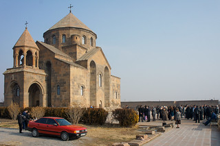 Immagine di Saint Hripsime Church. winter wedding red people car guests cathedral armenia armavir echmiadzin sthripsimechurch
