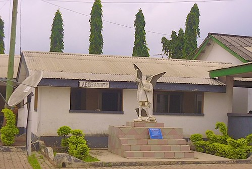 The Laboratory of St Michael's Hospital, Pramso, Ghana. Outside is a statue of St Micheal