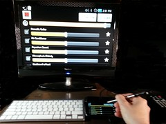 The final product. A Samsung Droid Charge connected to a bluetooth keyboard and an HDMI monitor