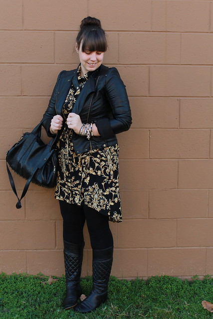 Scarf-print outfit: Forever 21 scarf-print shirtdress, black tights, quilted leather boots, spiky necklace, studded-bottom bag, motorcycle jacet