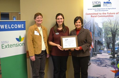 South Dakota State Director Elsie Meeks presents funds to South Dakota State University Extension for an online Local Foods Center while attending the 2012 South Dakota Local Foods Conference.  Pictured left to right, Dr. Rhoda Burrows and Chris Zdorovtsov, SDSU Extension; and State Director Meeks.