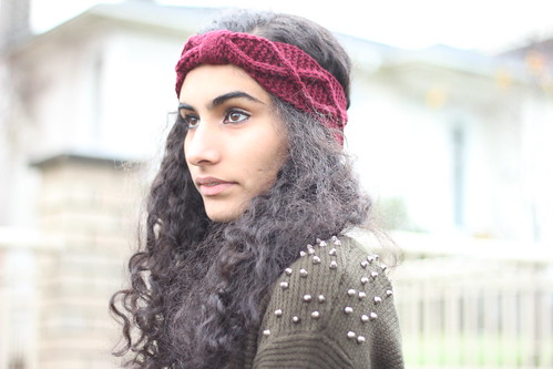studded sweater and knitted ear warmer