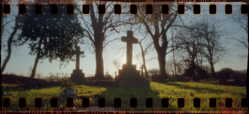 uk morning trees winter shadow england film cemetery grave graveyard sunrise 35mm memorial cross kodak hampshire pinhole gravestone marker 135 hursley c41 sprocketholes tetenal goldultra pp135v20