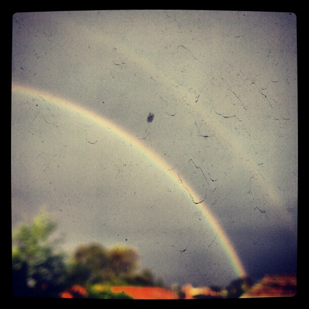 Double rainbow through dirty window