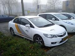honda civic(0.0), automobile(1.0), automotive exterior(1.0), family car(1.0), wheel(1.0), vehicle(1.0), honda(1.0), bumper(1.0), honda civic hybrid(1.0), sedan(1.0), land vehicle(1.0),