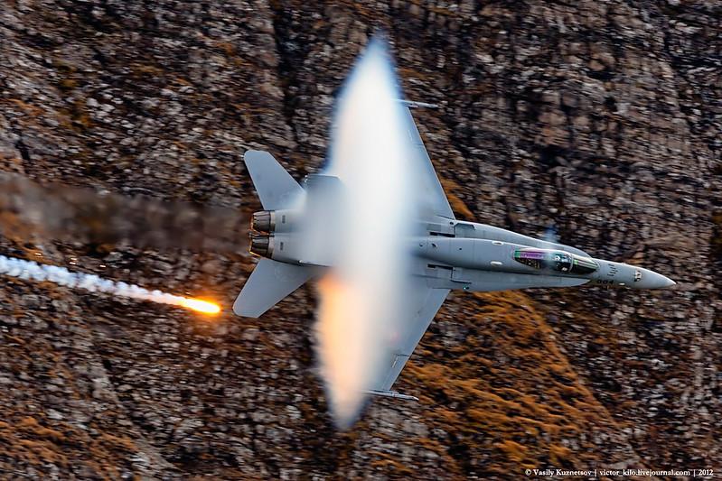 Swiss AirForce F/A-18 making a low pass at AXALP-2012