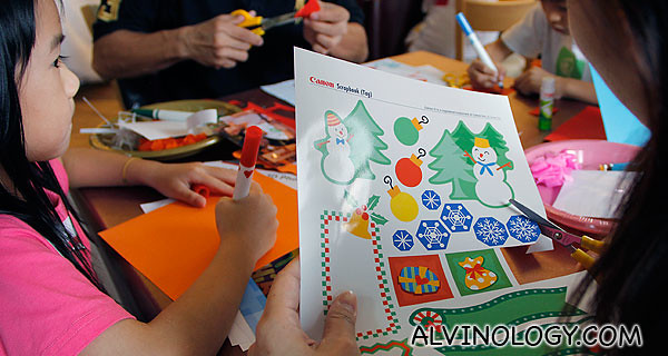 Cutting out Christmas themed decors from Canon Creative Park, printed using the Canon PIXMA