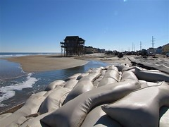 Sandy-destroyed sandbags no longer protect NC 12 at Mirlo Beach and Rodanthe
