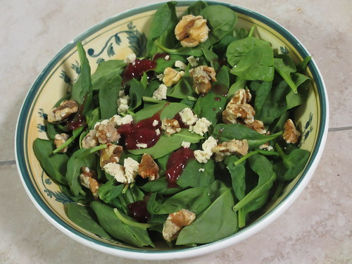 Spinach Salad with Walnuts, Goat Cheese, and a touch of Cranberry Sauce