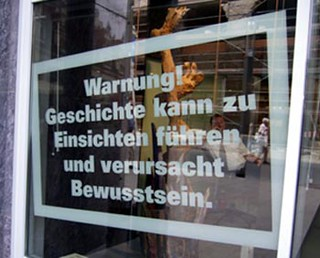 "A sign in the window of Leipzig's Forum of Contemporary  History contains cautions passers by with this message:  ""Warning! History can lead to insight and cause awareness."""