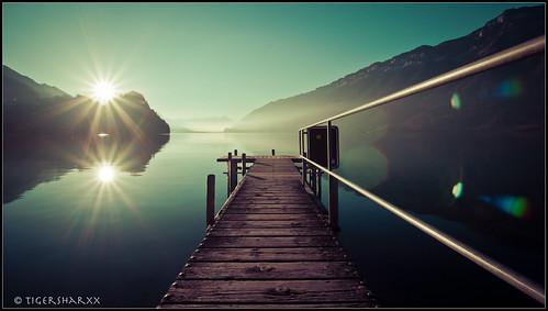 autumn sunset sun lake water lens landscape mirror see nikon brienzersee ghost herbst wideangle flare nikkor sonne spiegelung interlaken iseltwald d90 1024mm