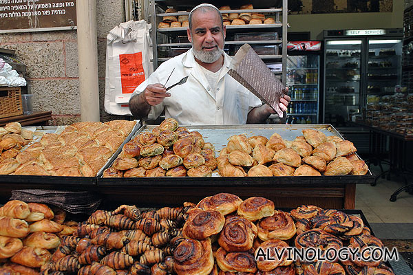 Friendly shopkeeper at this bakery