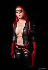 fetish model(1.0), model(1.0), latex clothing(1.0), clothing(1.0), red(1.0), photo shoot(1.0), lady(1.0), costume(1.0),