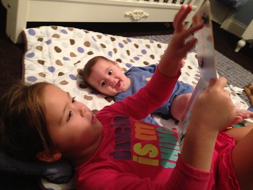 Hannah reading to her brother