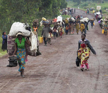 Civilians fleeing from the eastern Democratic Republic of Congo city of Goma. The United Nations Security Council has condemned actions by the M23 rebels who have reportedly siezed the important area. by Pan-African News Wire File Photos