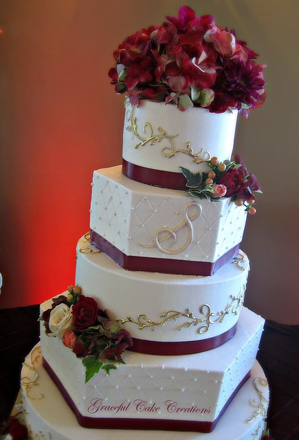 Elegant Ivory Buttercream Wedding Cake with Burgundy and ...