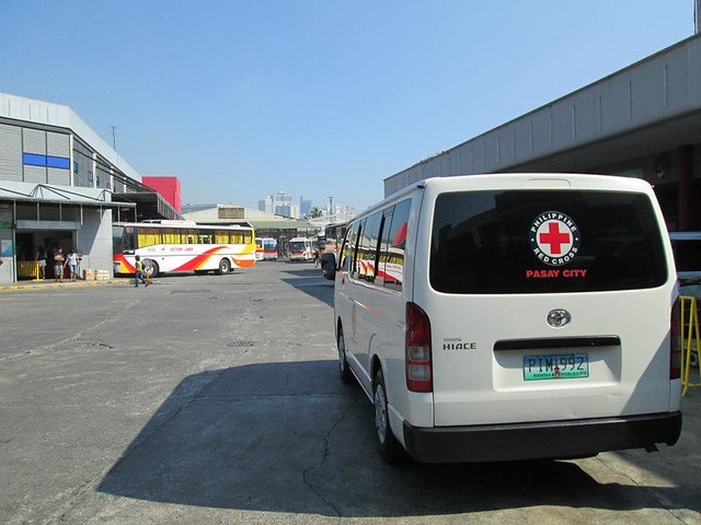 In this picture, you can see the van of our partner, Philippine Red