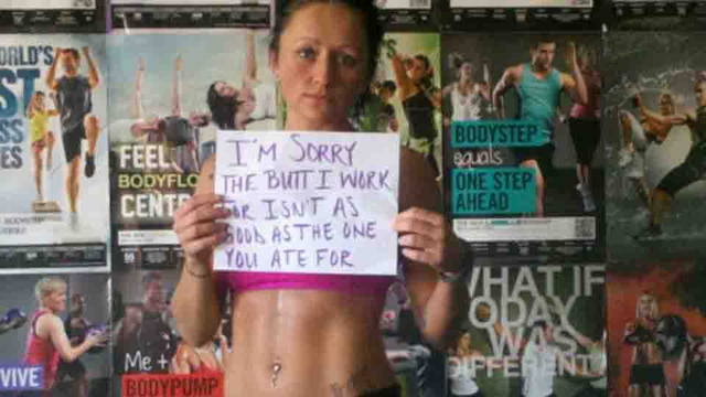 "woman holding a sign reading ""I'm Sorry the Butt I Work For Isn't As Good as the One You Ate For"""