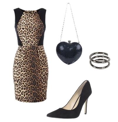Miranda Kerr wearing leopard print dress and black pumps