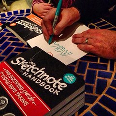 Signing books at last night's launch party. Note Linnea's little hands - she signed too!