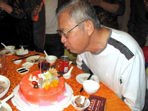 Trip to Fuzhou - Dad blowing the birthday cake