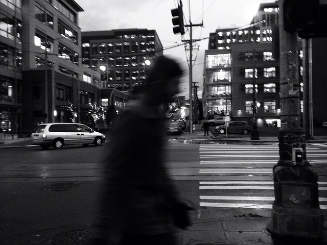 Photo of man crossing street