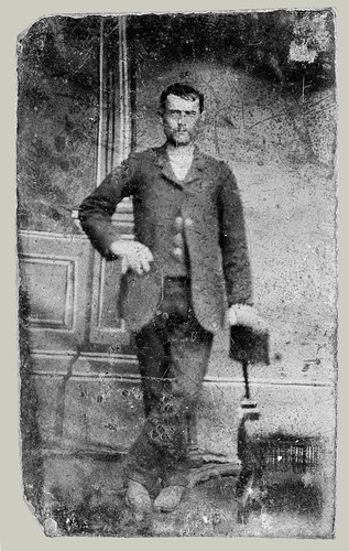 Man with fringed chair